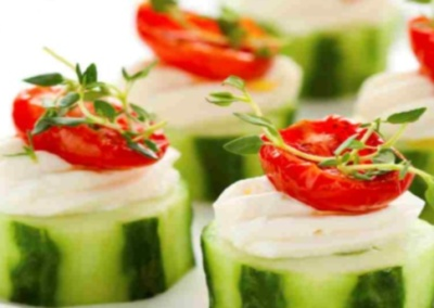 Holiday vegetable appetizers with cucumbers, soft cheese and sun dried tomatoes